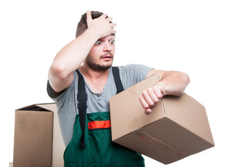 Mover guy holding cardboard gesturing being late