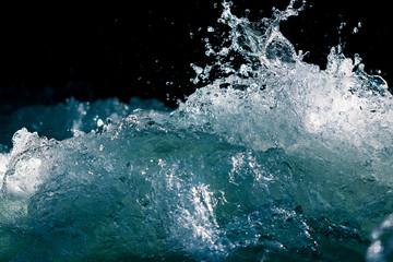Poster de jardin Eau Splash of stormy water in the ocean on a black background