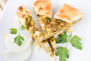 Spoed Fotobehang Voorgerecht Salty pie with egg, artichoke and onion