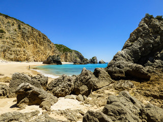 "Rock formations at the beautiful beach ""Praia da Ribeira do Cavalo"" in Sesimbra, Portugal."