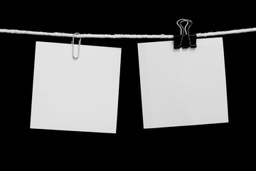 paper note hanging on a rope with clip