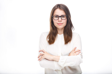 Beautiful young girl in glasses with a black rim a white shirt on an isolated background. Business concept