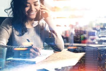 Cheerful Asian woman on phone, night city
