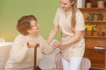 Nurse helping older lady