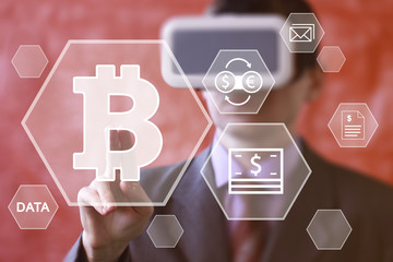 Businessman pushing button bitcoin web virtual reality network