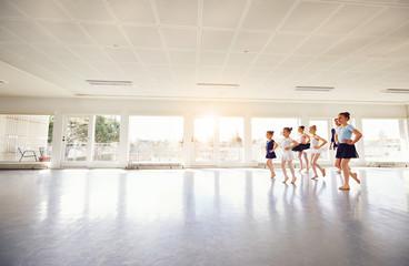 Group of children ballerinas practicing in ballet class