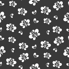 Butterflies and flowers on black background, seamless pattern. Vector background.