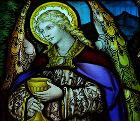 Fototapete - Angel holding a cup in stained glass