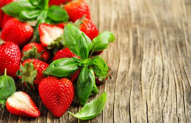 Fresh strawberries and basil leaves
