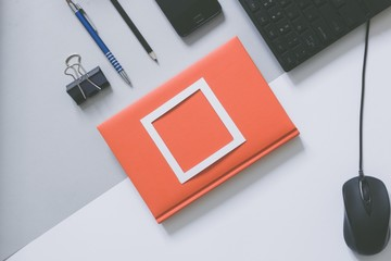 Top view of blank frame on pastel. Colored background office desk with different objects. Minimal flat lay style