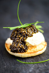 Russian Pancake Blini with Sour Cream and Black caviar