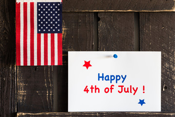 """A """"Happy 4th of July!"""" card and US flag on the reclaim wood."""
