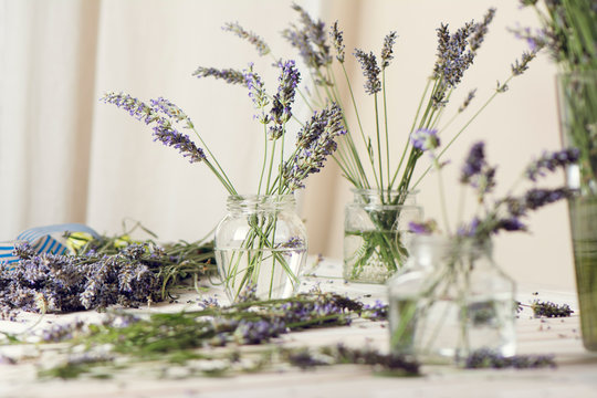Small bouquet of fresh lavender in jars with water