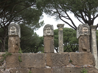 Ancient stone masks in the Roman theater of Ostia Antica