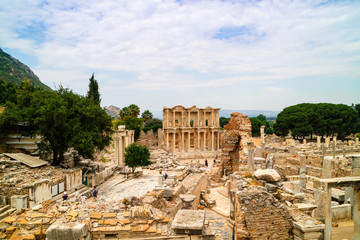 Ancient Roman Archaeological site with facade of the Library of Celsus in Ephesus, Anatolia a popular tourist attraction.
