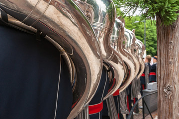 Tuba players seen on the back