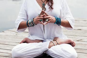 woman hand in yoga symbolic gesture mudra Wall mural