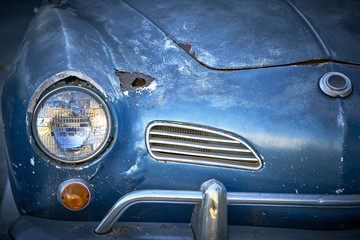 Vintage weathered unrestored blue German classic car with rust hole and tons of character