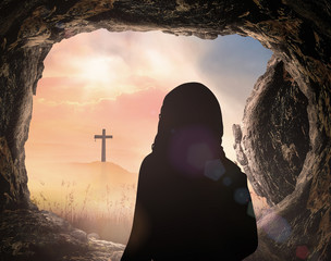 Resurrection of Easter Sunday  concept: Jesus Christ with empty tomb stone with cross on sunrise background