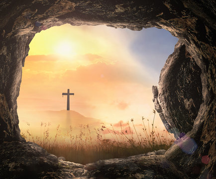 Resurrection of Jesus Christ concept: Tomb empty with cross at autumn sunrise background