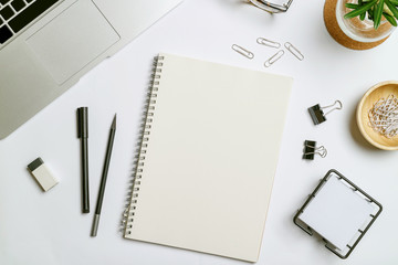Top view workspace mockup white background with notebook, pen and accessories.