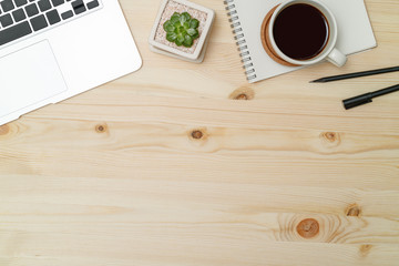 Top view workspace mockup on wood desk with notebook, pen and coffee.
