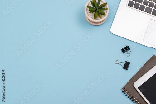 Top View Workspace Mockup On Blue Desk With Notebook Stock Photo
