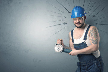 Worker standing with tool.