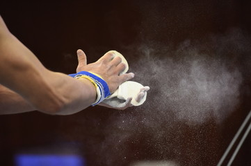 Fotobehang Gymnastiek mens Artistic Gymnastics hands Close up Grips and Chalk