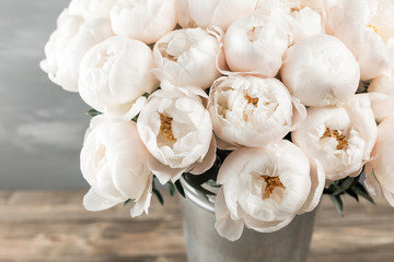 White peonies in vase. retro styled photo. close-up