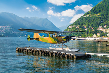 Seaplane of camouflage color. Como harbor, Como lake, Italy. Example of activities that can be done on Lake Como