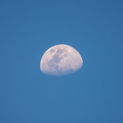 half moon with blue sky