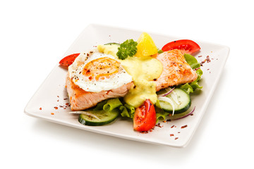 Grilled salmon with fried egg and vegetables on white background