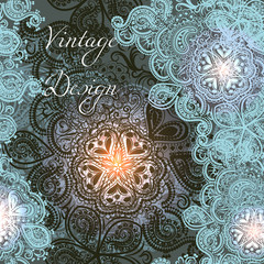 Elegant card with shiny Indian ornament pattern in beautiful blue and pink color