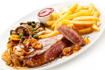 Grilled beef steak with french fries on white background