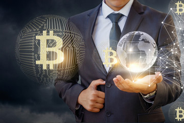 Businessman in network with bitcoin .