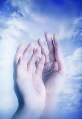 spiritual angel hands over divine mystical sky like a concept for faith, religion, spirit and soul, praying and prayer