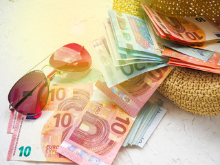 Straw hat, money, Bank cards, glasses glare, the concept of holiday, vacation, savings