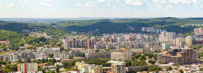 Aerial view of Lviv city. Panorama with modern buildings and urban space.