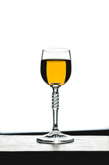 glass with yellow liquid, alcoholic beverage in wine glass