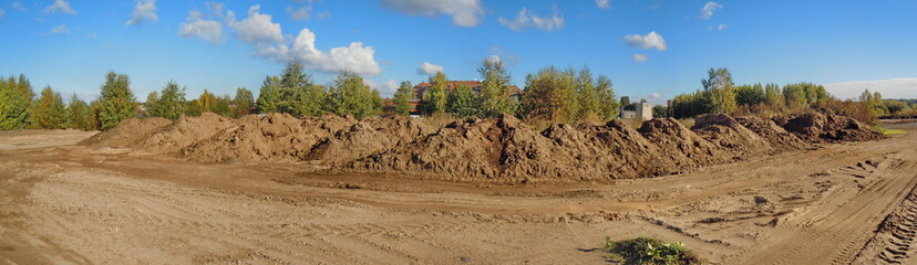 Panoramic view of pile of ground and sand field