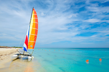 Wall Mural - Varadero beach in Cuba with a colorful sailboat