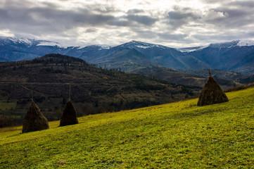 haystack on the rural field on hillside
