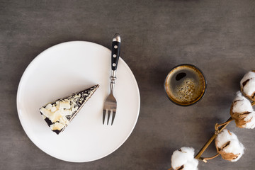 Healthy raw vegan chocolate coconut cake  from above on a gray background. Dark food photography concept