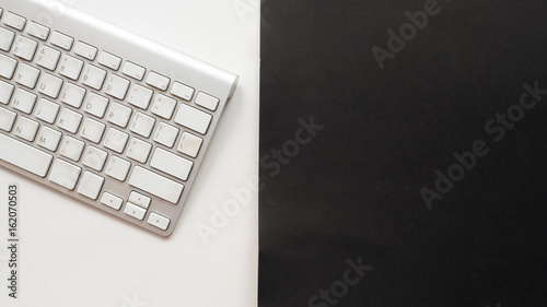 Wall mural keyboard copy space on white and black background