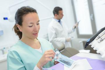 nurse preparing an injection syringe