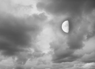 Moon in the dark cloudy sky