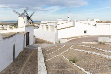 white windmills and white houses in Campo de Criptana town, province of Ciudad Real, Castilla-La Mancha, Spain