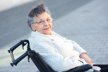 elderly woman in wheelchair posing
