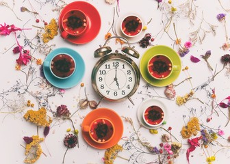 healthy organic tea and alarm clock